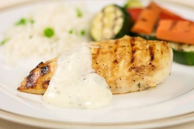 Grilled Low fat chicken breast with yoghurt sauce and grilled vegetables