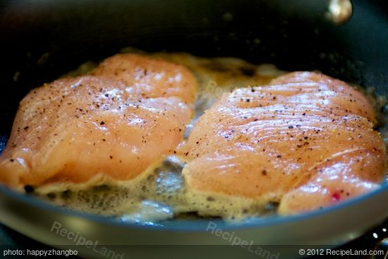 Add the chicken breasts into hot pan with bubbling butter.