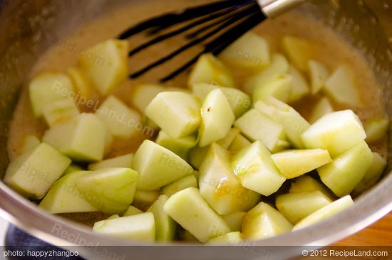 Add the apples into liquid mixture.