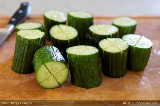 Cut each log of cucumber into a cross