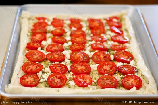 Place tomato slices,