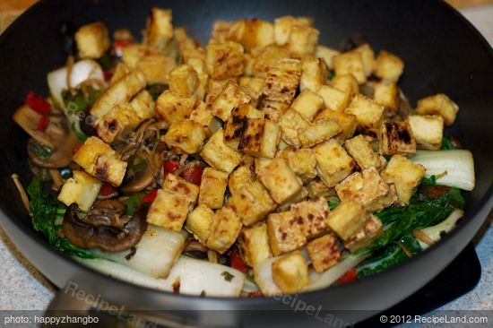 Add the tofu cubes back into the wok or skillet,