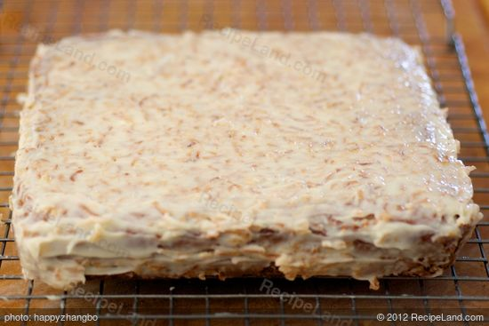 Spread icing evenly over cake,