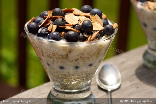 This breakfast parfait is made with quinoa, yogurt, fresh blueberries ...