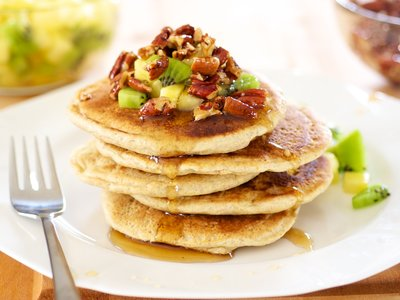 Whole Wheat Pancakes with Maple Candied Pecans and Tropical Fruit