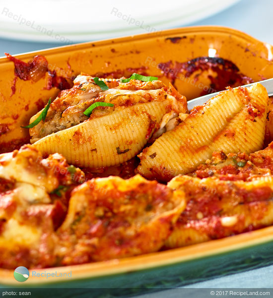 Beef stuffed inside large pasta shells topped with gooey cheese then baked to perfection. Make-ahead and it's freezer friendly.