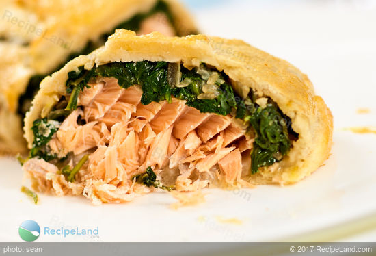 Juicy salmon with spinach stuffed inside of flaky puff pastry.