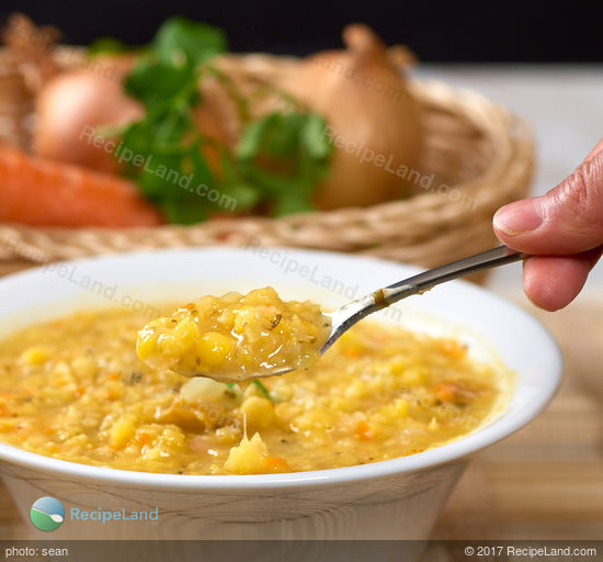 Close-up of a spoonful of yellow-split pea soup