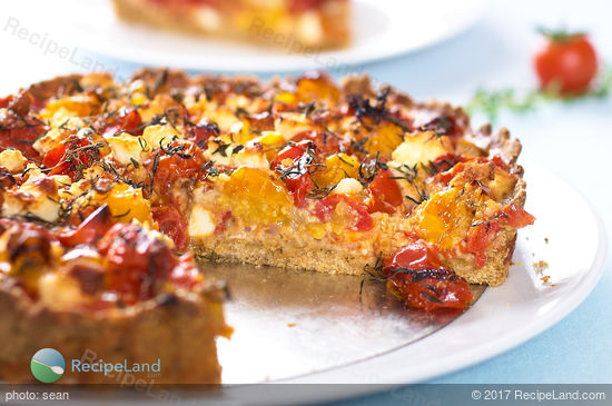This delicious savory tart is made with roasted cherry tomatoes, feta cheese, and fresh herbs. It's cheesy, sweet, juicy and very tasty. You can have it as an appetizer or a main dish!