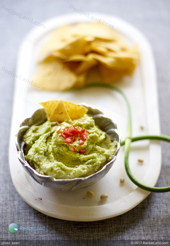 Garlic scapes lift this bean dip into a seasonal, delicious and healthy beginning of summer dip.A fluffy and billowing fresh green colored dip with a velvety texture and mildly assertive green garlic warmth to wrap around any crudites of your choosing.