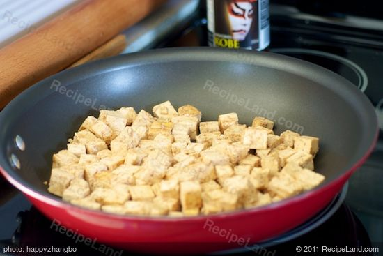 Place the marinated tofu in the pan