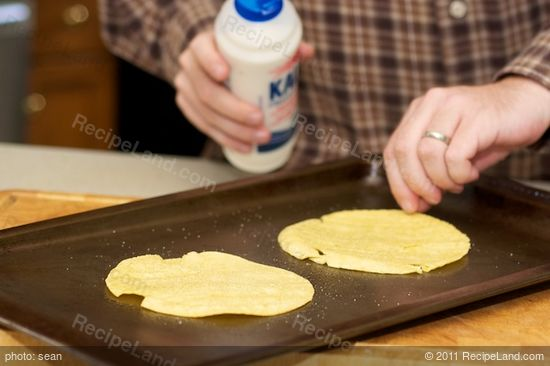 Season the corn tortillas and pop them in the oven