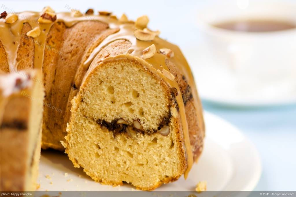 Coffee Streusel Bundt Cake With Glaze And Hazelnuts Topping