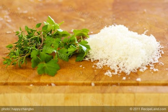 While the bread crumbs are baking, grate some parmesan and chop some fresh thyme leaves and parsley...