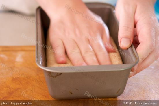 Place each cylinder of dough into one of the prepared loaf pans and gently press it...