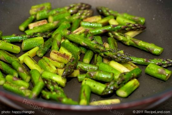 Cook until the asparagus is browned and almost tender, 4 to 5 minutes, stirring once.