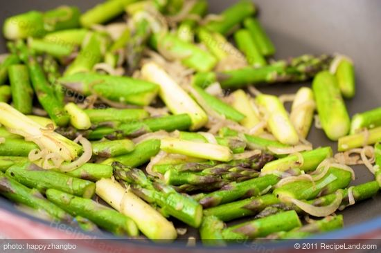 Cook until softened and asparagus is tender-crisp, about 1 minute, stirring often.