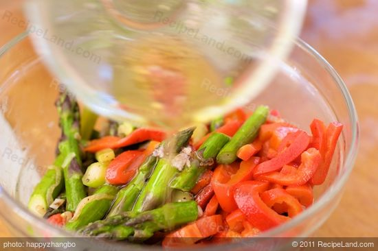 Pour the remaining dressing over the asparagus and roasted bell pepper.