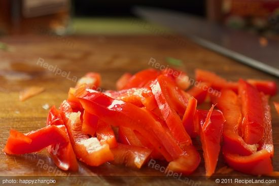 Slice the red bell pepper.