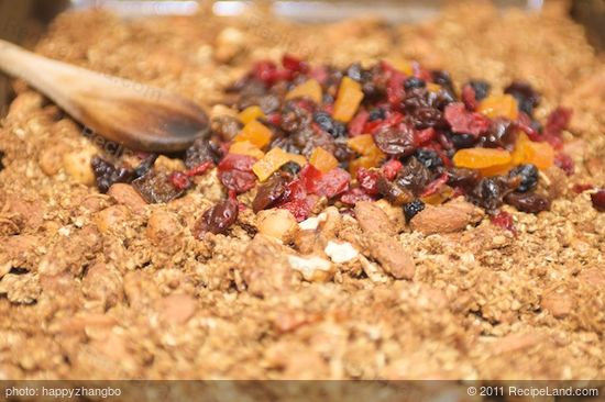 Add half of the dried fruits into each baking sheet.