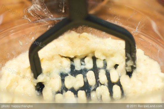 Using a potato masher or fork mash the bananas.