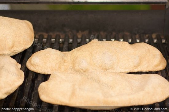 Time to grill the pizza dough. Place the pizza dough on the grill.