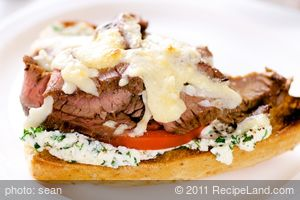 Open-face Flank Steak Sandwiches with Herbed Goat Cheese and Tomatoes