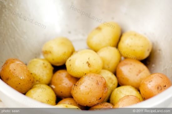 Toss the scrubbed potatoes in some olive oil, salt, pepper