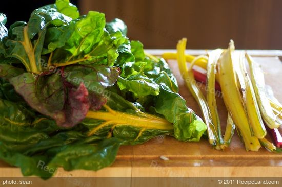 Meanwhile wash the chard very well, chop off the tough ends, and separate the stems and leaves.