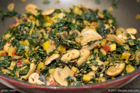 Add the chard leaves, stems and kale leaves, stirring,