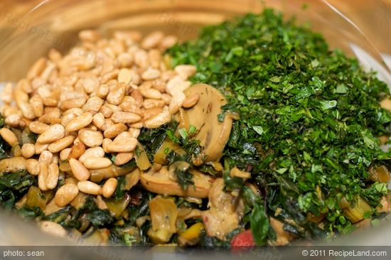Remove from the heat, and transfer the vegetable mixture into a large bowl,