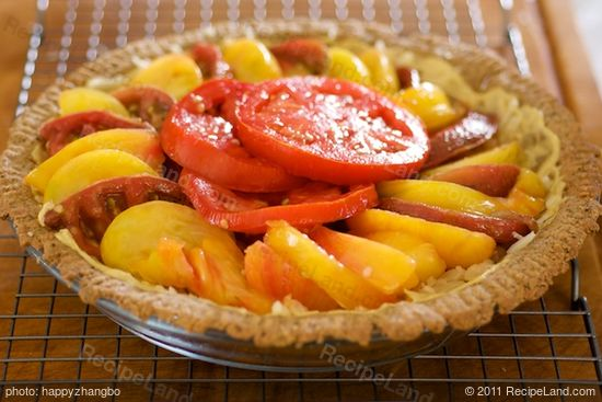 Arrange the tomatoes over the cheese in 1 overlapping layer.