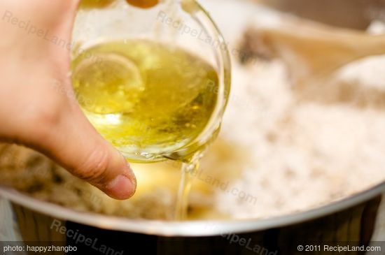 pour in the canola or olive oil,