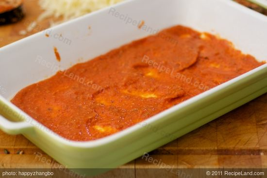 Time to assemble. Spread a thin layer of tomato sauce over the bottom of a 11 x 7 x 2 inch baking dish or a square dish.
