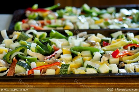 Toss the vegetables with olive oil, salt, black pepper and herbs in a large bowl, then spread onto one or two baking sheets.