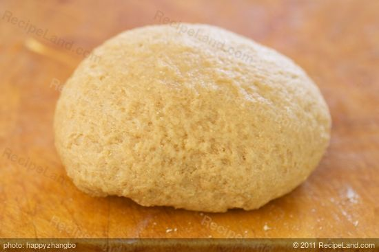 Use your hand to knead the dough a few times more until soft ball forms.