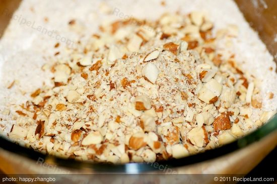 Add toasted almonds and chop coarsely, using 6 to 8 on/off turns.