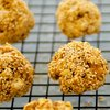 Double Peanuts and Honey Christmas Popcorn Balls with Sesame Coating