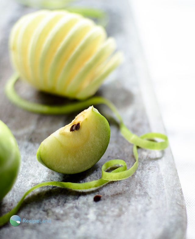 Granny Smith apple wedge and spiral sliced