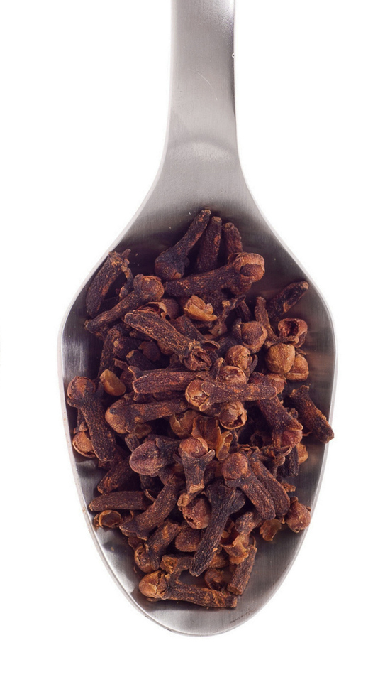 whole cloves on spoon
