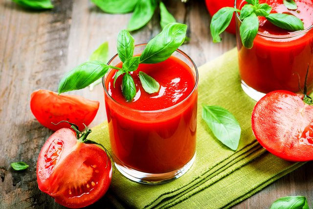 Fresh tomato juice with tomatoes and basil